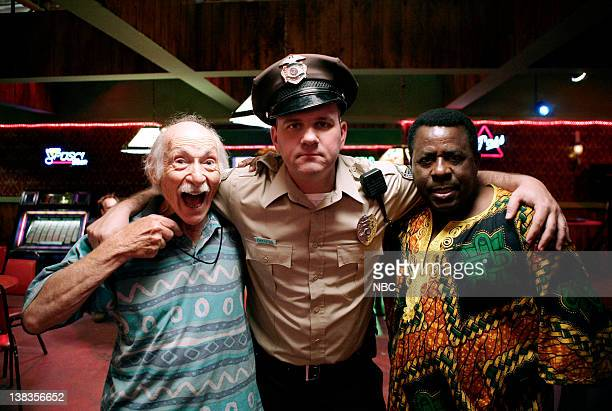 """Our 'Cops' Is On!"""" Episode 12 -- Pictured: Jake Axelrod as Electrolarynx Guy, Mike O'Malley as Officer Stuart Daniels, Abdoulaye NGom as..."""