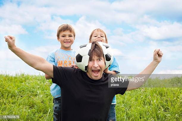 our dad is a football fan! - crazy dad stock photos and pictures