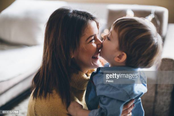 our everyday moments - mother and son stock photos and pictures