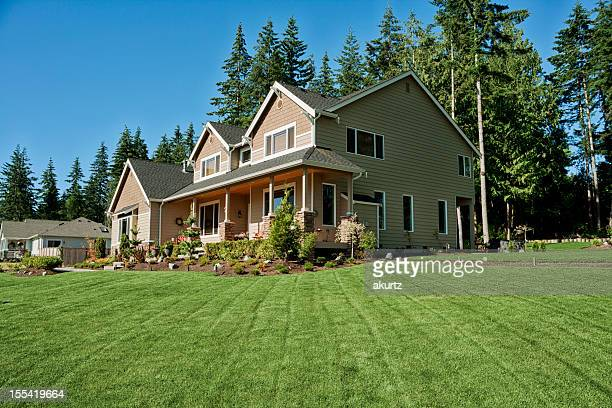 Our home with fresh cut lush green grass