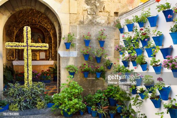 Our lady of Bethlehem and Shepherds Chapel with potted flower courtyard during Spring festival Cordoba