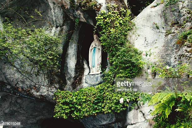 our lady of lourdes in the cave - our lady of lourdes stock pictures, royalty-free photos & images