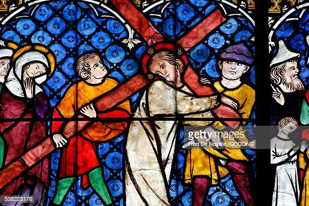 our lady of strasbourg cathedral. stained glass window xivth century. jesus carrying his cross. - stained glass stock photos and pictures