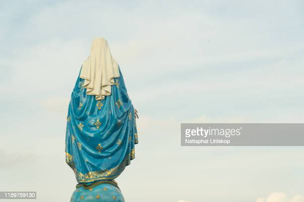 our lady, the blessed virgin mary on blue sky background. - blessed mother mary stock pictures, royalty-free photos & images