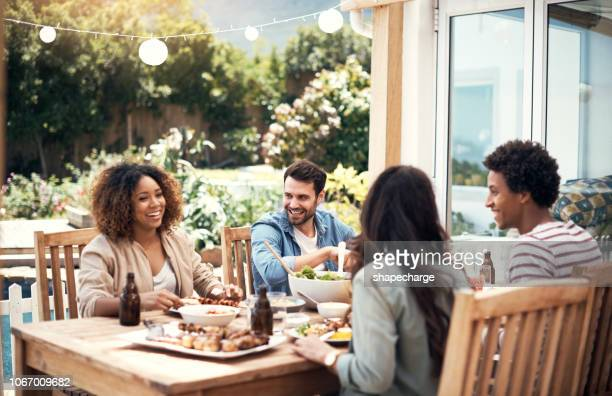 our love for food is a common thread - barbecue social gathering stock pictures, royalty-free photos & images
