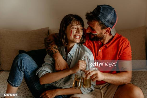 our love in front of any national teams - international match stock pictures, royalty-free photos & images