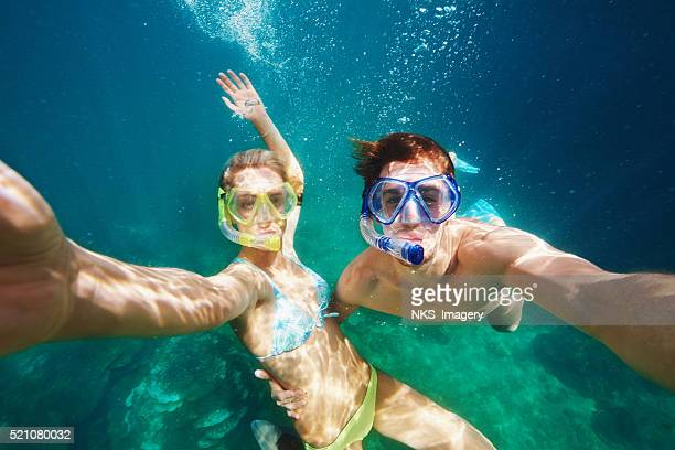 our love is under pressure... - snorkeling stock pictures, royalty-free photos & images