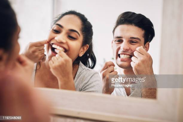 our love shines as bright as our teeth - dental floss stock pictures, royalty-free photos & images