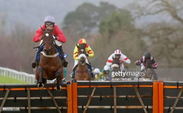 Our Merlin and Harry Cobden clear the last flight before going on to win The Dave Criddle Travel Wendy Wu Tours Handicap Hurdle Race run at Taunton...