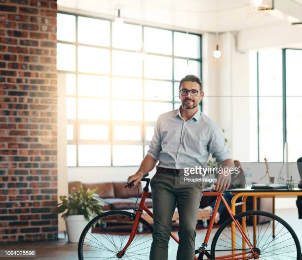 our office is bicycle friendly - carbon footprint stock pictures, royalty-free photos & images