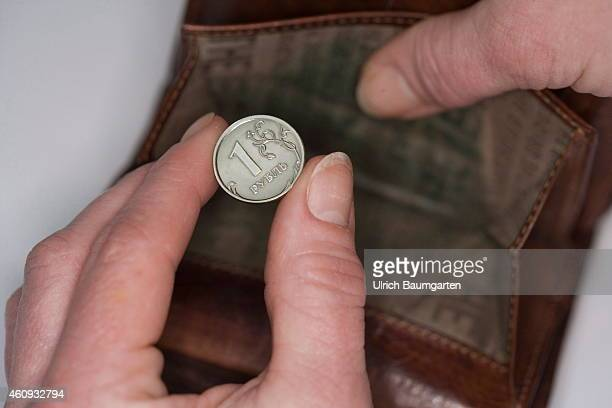 Our picture shows a Russian 1 Ruble coin and an empty purse on December 31 2014 in Bonn Germany