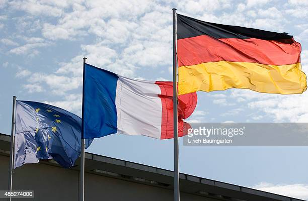 Our picture shows the flags of Germany France and Europe at the Federal Chancellery in Berlin