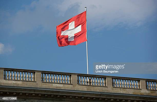 Our picture shows the Swiss flag at the Swiss Embassy in Berlin