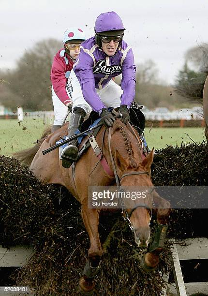 'Our Prima Donna' ridden by Tony McCoy goes through the fence as winner 'Bak To Bill' ridden by Miss L Gardner goes on to win The Ludlow For...