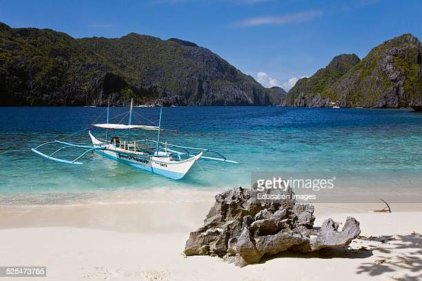 Our Small Boat Anchored On A White Sand Beach On Matinloc Island Near El Niño Palawan Island Philippines