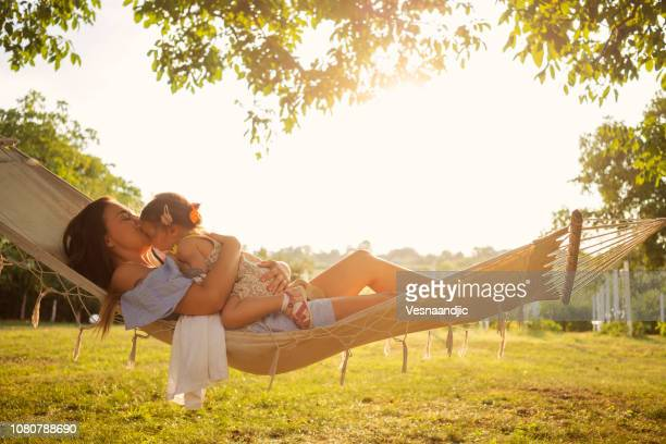 our time in hammock - hammock stock pictures, royalty-free photos & images