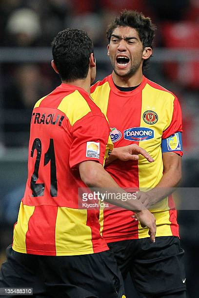 Ousama Darragi of Esperance Sportive de Tunis celebrates his goal against AlSadd with teammate Mejdi Traoui during the FIFA Club World Cup Quarter...