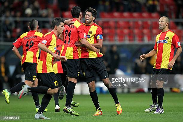 Ousama Darragi of Esperance Sportive de Tunis celebrates his goal against AlSadd with teammates during the FIFA Club World Cup Quarter Final match...