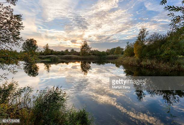 ouse fen sunset clouds, needingworth, cambridgeshire, east anglia uk - ouse river stock photos and pictures