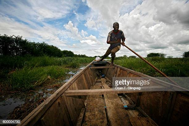 Ousman attempts to free his boat from the grass in what used to be a vast lake The shallow Lake Chad is shrinking dramatically believed by some to be...