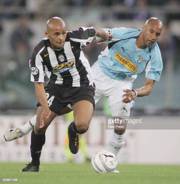 Ousmane Dabo of Lazio is beaten by Ruben Olivera of Juventus in the Serie A match between Lazio and Juventus at the Stadio Olimpico on April 24 2005...
