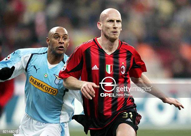 Ousmane Dabo of Lazio struggles for control of the ball against Jaap Stam of AC Milan during the Italian Serie A football match at San Siro stadium...