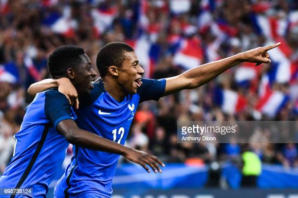 Ousmane Dembele and Kylian Mbappe of France celebrates the third goal during the International friendly match between France and England at Stade de...