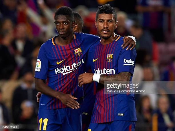 Ousmane Dembele and Paulinho of Barcelona celebrate after the La Liga match between Barcelona and Espanyol at Camp Nou on September 9 2017 in...