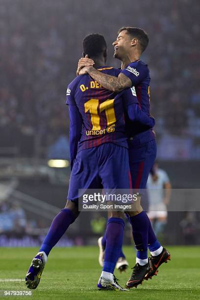 Ousmane Dembele and Philippe Coutinho of FC Barcelona celebrate the first goal during the La Liga match between Celta de Vigo and Barcelona at...