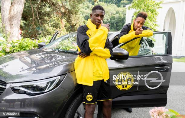 Ousmane Dembele and PierreEmerick Aubameyang of Borussia Dortmund during a game called 'Quiz Taxi' for the sponsor Opel as part of the training camp...