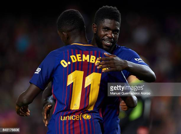Ousmane Dembele and Samuel Umtiti of Barcelona celebrate during the La Liga match between Barcelona and Espanyol at Camp Nou on September 9 2017 in...