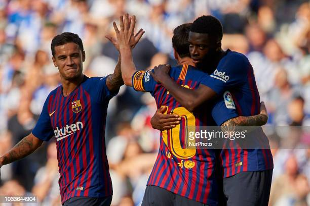 Ousmane Dembele celebrates after scoring his sides first goal whit Coutinho Lionel Messi during the match between Real Sociedad against FC Barcelona...