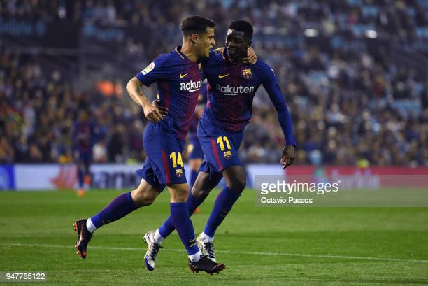 Ousmane Dembele celebrates with Philippe Coutinho of Barcelona after scores the first goal during the La Liga match between Celta de Vigo and...