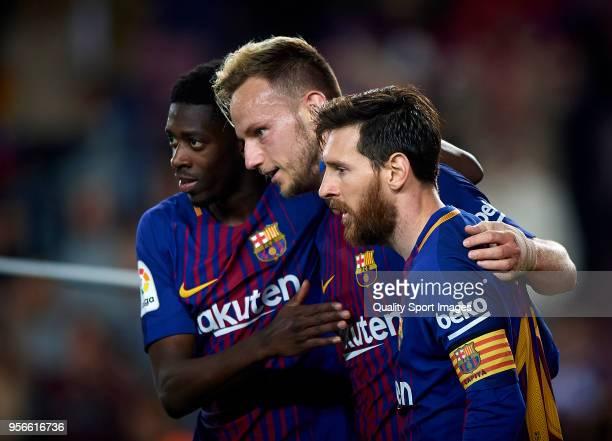 Ousmane Dembele Lionel Messi and Ivan Rakitic of Barcelona celebrates a goal during the La Liga match between Barcelona and Villarreal at Camp Nou on...