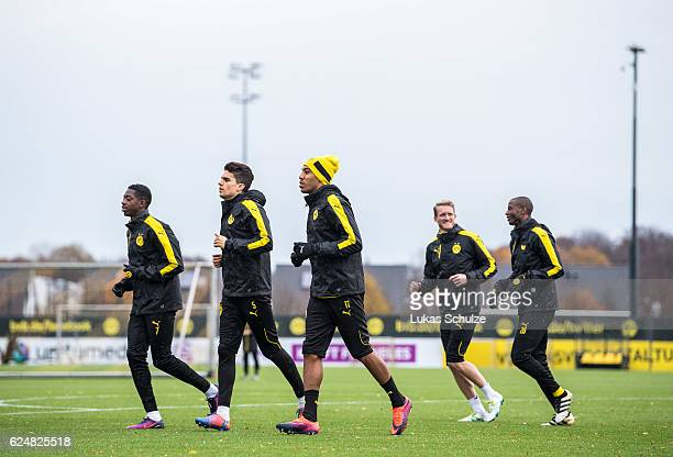 Ousmane Dembele Marc Bartra PierreEmerick Aubameyang Andre Schuerrle and Adrian Ramos warm up during a training session ahead of their Champions...