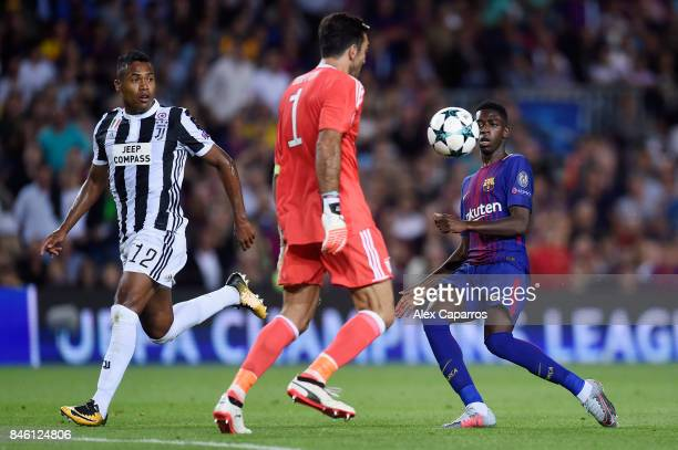 Ousmane Dembele of Barcelona attempts to get a touch on the ball as Gianluigi Buffon of Juventus attempts to collect during the UEFA Champions League...