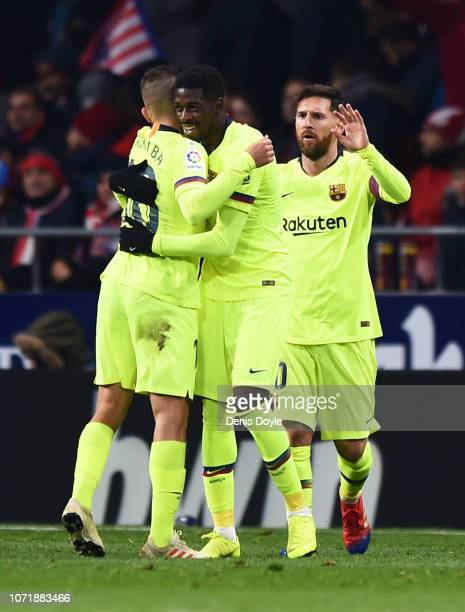Ousmane Dembele of Barcelona celebrates after scoring his team's first goal with Jordi Alba and Lionel Messi during the La Liga match between Club...