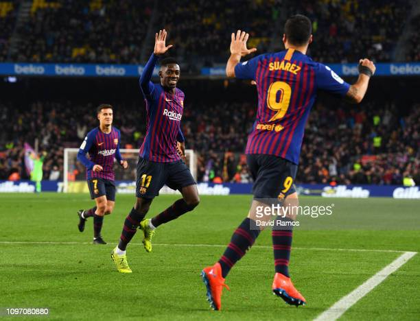 Ousmane Dembele of Barcelona celebrates after scoring his team's first goal with Luis Suarez during the La Liga match between FC Barcelona and CD...
