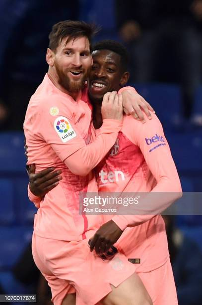 Ousmane Dembele of Barcelona celebrates after scoring his team's second goal with Lionel Messi of Barcelona during the La Liga match between RCD...