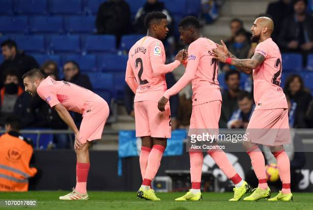 Ousmane Dembele of Barcelona celebrates after scoring his team's second goal with Arturo Vidal of Barcelona during the La Liga match between RCD...