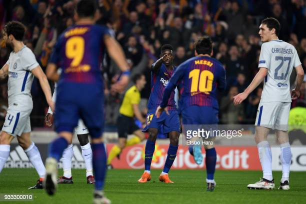Ousmane Dembele of Barcelona celebrates scoring his side's second goal with his team mate Lionel Messi during the UEFA Champions League Round of 16...