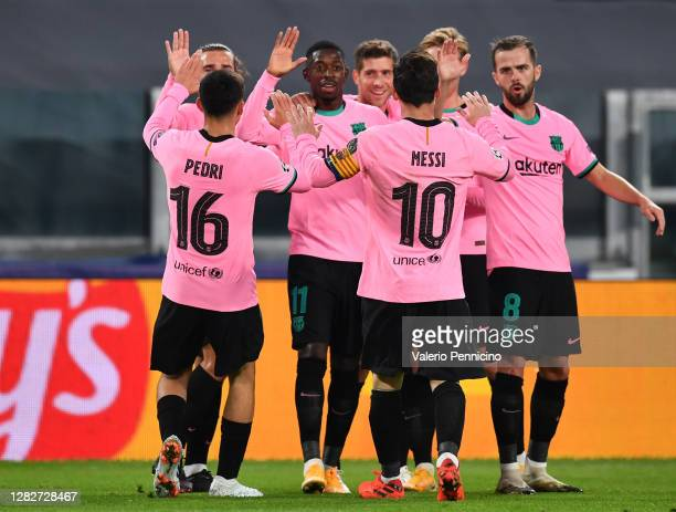 Ousmane Dembele of Barcelona celebrates with his team mates after scoring his sides first goal during the UEFA Champions League Group G stage match...