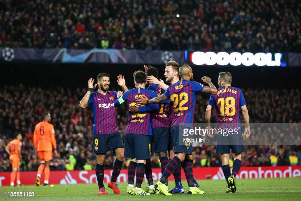 Ousmane Dembele of Barcelona celebrates with his teammates after scoring his sides fifth goal during the UEFA Champions League Round of 16 Second Leg...