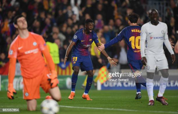 Ousmane Dembele of Barcelona celebrates with Lionel Messi as he scores their second goal as Thibaut Courtois and N'Golo Kante of Chelsea look...