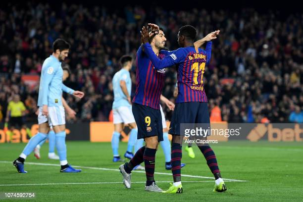 Ousmane Dembele of Barcelona celebrates with teammate Luis Suarez after scoring his team's first goal during the La Liga match between FC Barcelona...