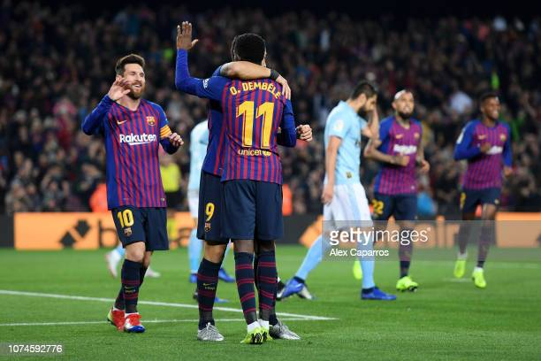 Ousmane Dembele of Barcelona celebrates with teammates Lionel Messi and Luis Suarez after scoring his team's first goal during the La Liga match...
