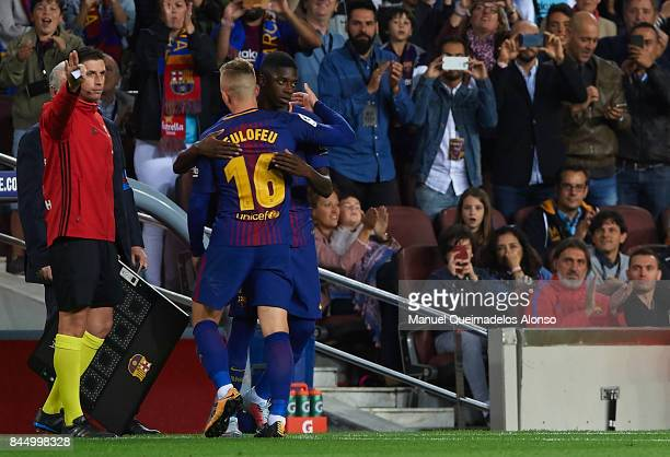 Ousmane Dembele of Barcelona embrances with substitute Gerard Deulofeu of Barcelona during the La Liga match between Barcelona and Espanyol at Camp...