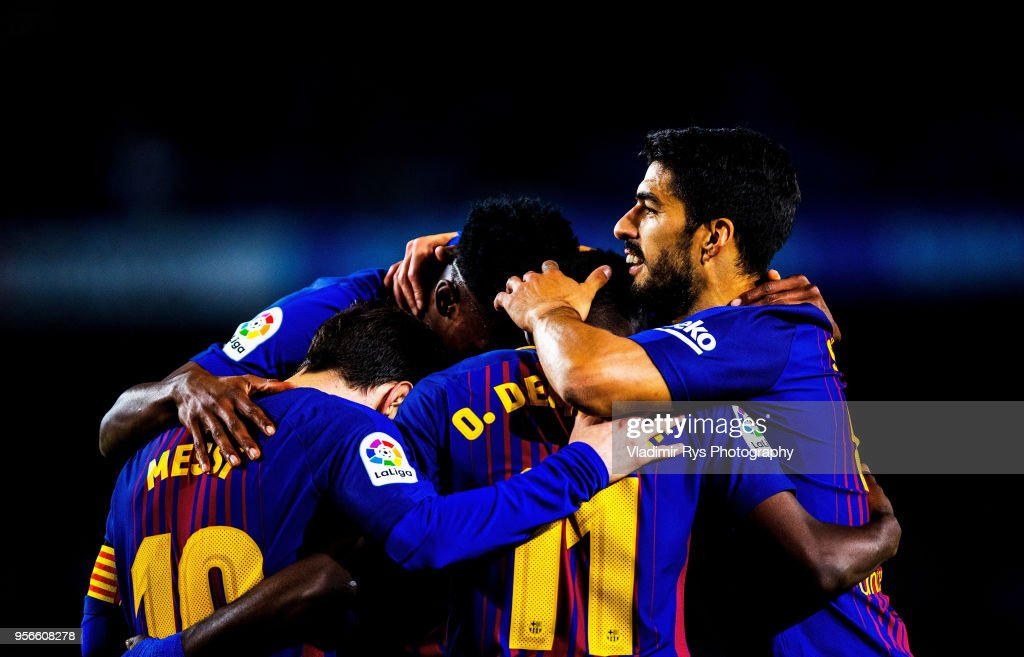 Ousmane Dembele of Barcelona is celebrated by his team mates Lionel Messi (L), Yerry Mina (M) and Luis Suarez after scoring his team's fifth goal during the La Liga match between FC Barcelona and Villarreal CF at the Camp Nou stadium on May 09, 2018 in Barcelona, Spain.