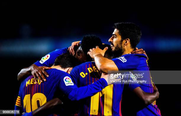 Ousmane Dembele of Barcelona is celebrated by his team mates Lionel Messi Yerry Mina and Luis Suarez after scoring his team's fifth goal during the...
