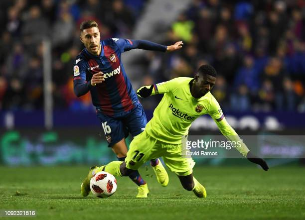 Ousmane Dembele of Barcelona is challenged by Ruben Rochina of Levante during the Copa del Rey Round of 16 match between Levante and FC Barcelona at...